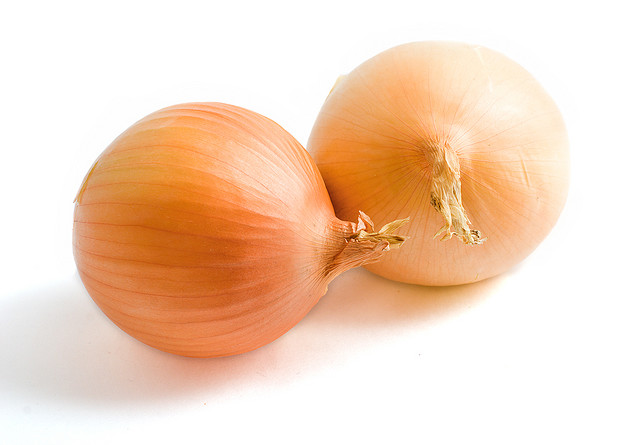 two yellow onion bulbs